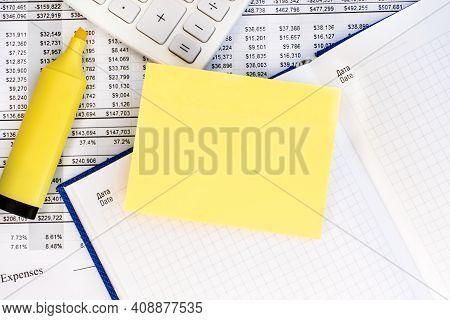 A Yellow Blank Sheet Lies On A Notebook With A Checkered Sheet. A Financial Document And A White Cal