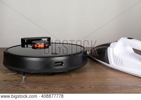 Picture Of An Automatic Intelligent Robotic Vacuum Cleaner With Mop On The Floor