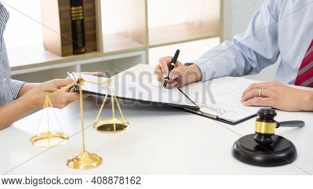 Client With His Partner Lawyers Or Attorneys Discussing Discussing A Document Or Contract Agreement