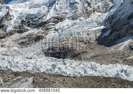 The Khumbu Glacier Nearly Everest Base Camp In Nepal Underneath Moraine Rocks. Moraines Are Formed F