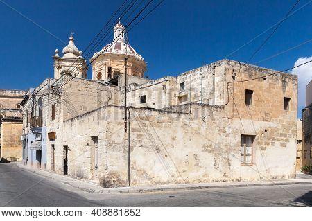 Malta, Rabat Street View. Corner Of Sant Antnin And Il-kullegg Streets. Domes Of The Basilica Of St