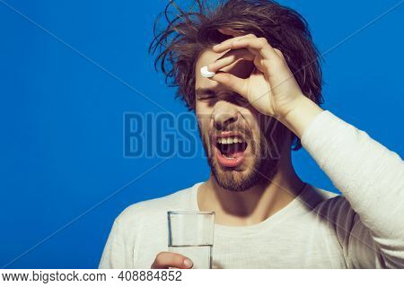 Man Drink Pill With Water From Glass. Antidepressant. Health And Medicine. Guy Hold Dieting Pill Or