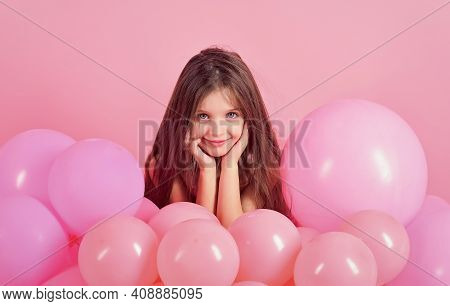 Little Girl In Pink Balloons. Small Girl Child With Party Balloons, Celebration. Birthday, Happiness