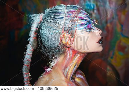Body Art. Young Woman Muse With Creative Body Art And Hairdo. Beautiful Woman With Art Makeup. Abstr