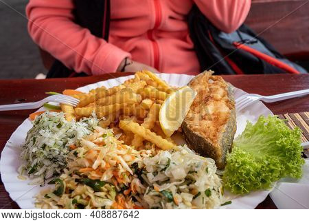 Fried Fish With Fries And Vegetable Salad