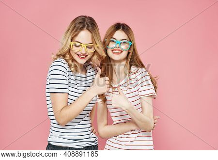 Two Girlfriends In Striped T-shirts Wearing Glasses Fashion Fun Lifestyle Isolated Background