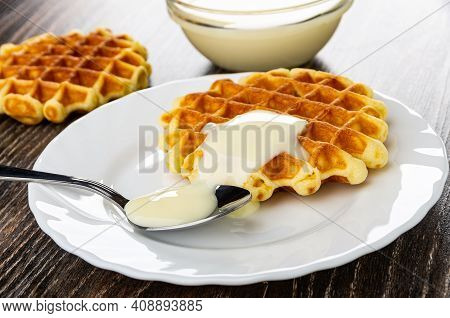 Waffle, Transparent Bowl With Condensed Milk, White Plate With Biscuit Waffle Poured Condensed Milk,