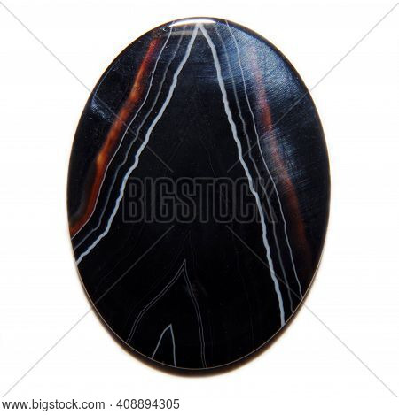Natural Black Agate Cabochon On White Background