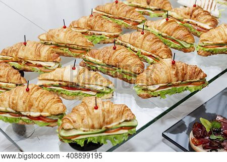 Rows Of Sandwich Croissants On The Table. Catering For Business Meetings, Events And Celebrations.