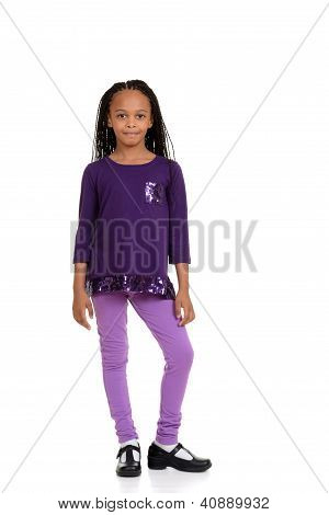 young african child wearing purple outfit
