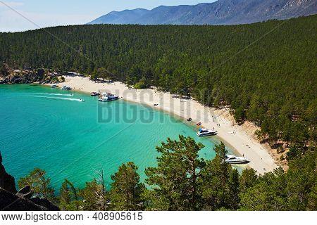 The Beautiful Sandy Beach On Summer Sunny Day. Lake Baikal, The Sandy Bay. Yachts Near The Shore, To