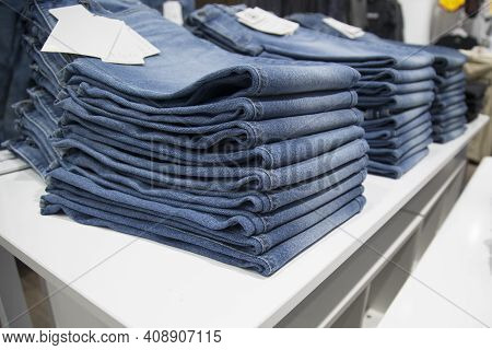 A Store That Sells Jeans. Jeans On The Counter Of The Store.
