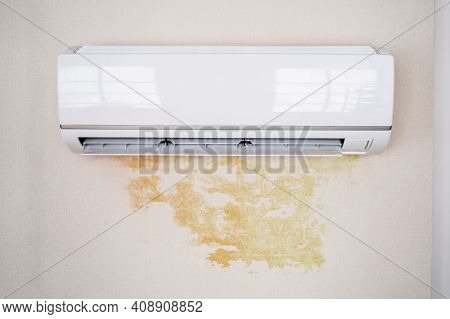 Leaky Air Conditioner And Water Damage On Wall At Home