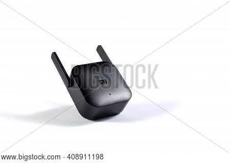 Editorial Image Of Wifi Amplifier Xiaomi Pro Isolated On A White With Copy Space.