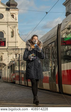 Brno, Czech Republic. 02-17-2021. Woman With Face Mask To Protect Corona Virus On Cheska Tram Stop W