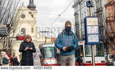 Brno, Czech Republic. 02-17-2021. Man With Face Mask To Protect Corona Virus On Cheska Tram Stop Wit