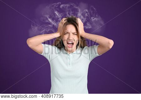 Stressed And Upset Young Woman On Violet Background