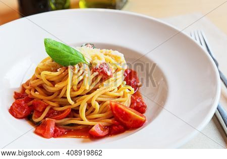 Spaghetti Pasta With Tomatoes And Basil Leaf On Wooden Table. Traditional Italian Pasta Spaghetti Wi