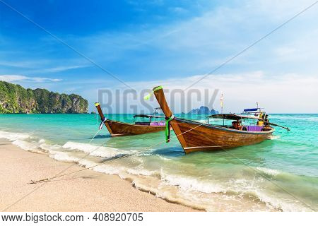 Thai Traditional Wooden Longtail Boat And Beautiful Sand Beach In Krabi Province. Ao Nang, Thailand.