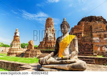 Wat Mahathat In Buddhist Temple Complex In Ayutthaya Near Bangkok, Thailand. Buddha Silhouette Of Bi