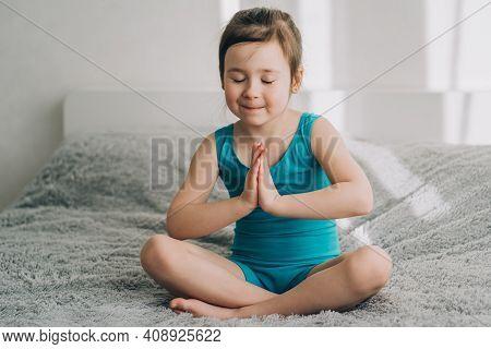 The Girl Prays In The Morning. Morning Prayer For A Child. Girl Meditates In Silence