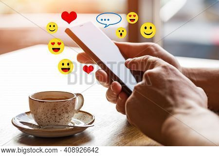 Close Up Of Man's Hands Holding Mobile Smart Phone With Blank Copy Space Screen. Image Of Man Sittin