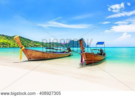 Thai Traditional Wooden Longtail Boats And Beautiful Sand Beach At Koh Phi Phi Island In Krabi Provi