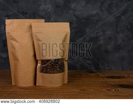 Pouch Bag Mockup. Blank Brown Kraft Paper Pack With Coffee Beans Wooden Background Advertising Copy