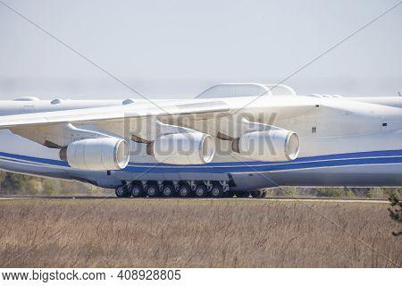 Three Engines Under One Wing And Cargo Plane Landing Gear. Turbines, Aircraft Engine. Wheels, Landin