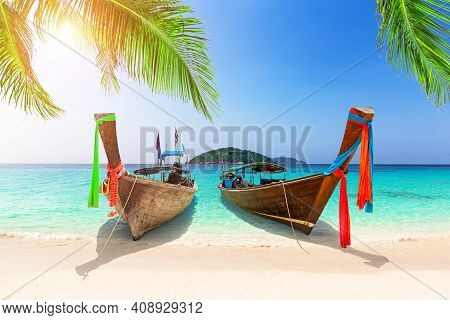 Beautiful Beach With Thai Traditional Wooden Longtail Boat And Blue Sky In Similan Islands, Thailand