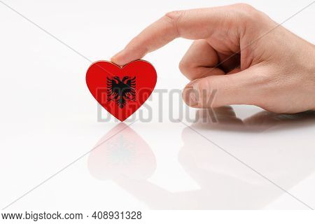 Albania Flag. Love And Respect Albania. A Man's Hand Holds A Heart In The Shape Of The Flag Of Alban