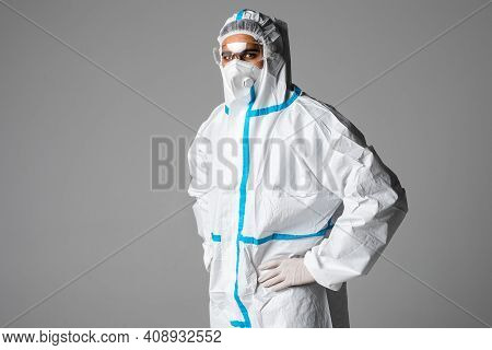 Portrait Of Man Doctor Wearing Googles, Protective Glasses In Protection Suit, Face Surgical Mask On