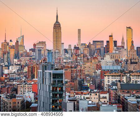 New York City, USA midtown Manhattan skyline at dusk.