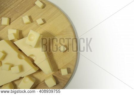 Emmental Cheese Close Up On A Cutting Round Board 01