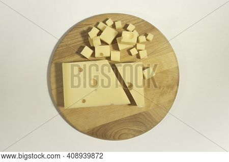Emmental Cheese Close Up On A Cutting Round Board 03
