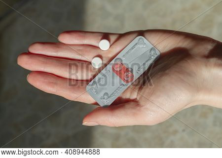 Two Pills For Emergency Contraception On The Hand Of A Woman.