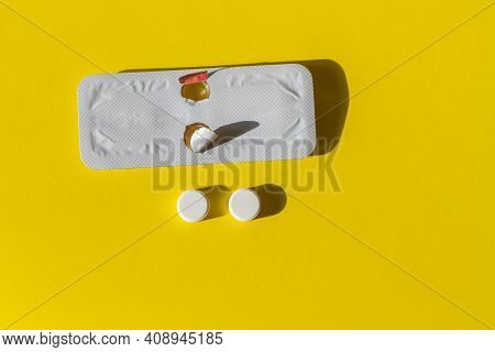 Two Pills For Emergency Contraception And A Blister On A Yellow Background.