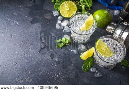 Summer Paloma Cocktail, Vodka Lime, Mojito Or Gin Tonic With Lime Wedge And Crushed Ice In Rocks, Tw