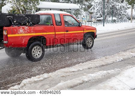 Roadside Assistance Car Driving Driving On A Snowy Street Of The Athens City, Greece, 16th Of Februa