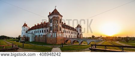 Mir, Belarus - August 11, 2017: Ancient Medieval Castle On A Sunset Background. Fortress In Mir, Bel