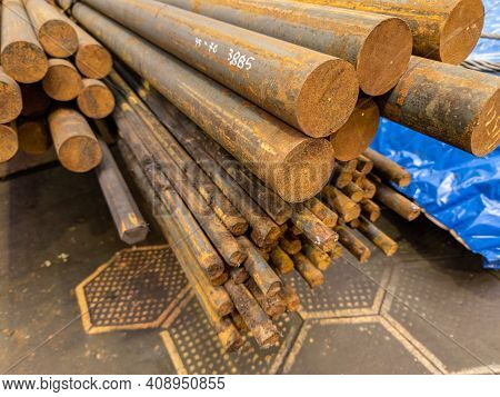 Rusted Round Steel Bars Pack - Close-up View On Ends With Selective Focus
