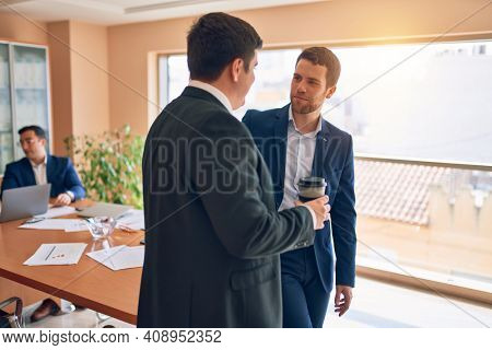 Business lawyers workers meeting at law firm office. Professional executive partners working on finance strategy at the workplace