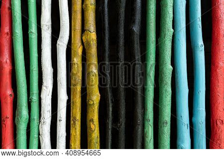 Brightly Colored Vertical Stick Fencing. Super Rustic Do It Yourself Feel.