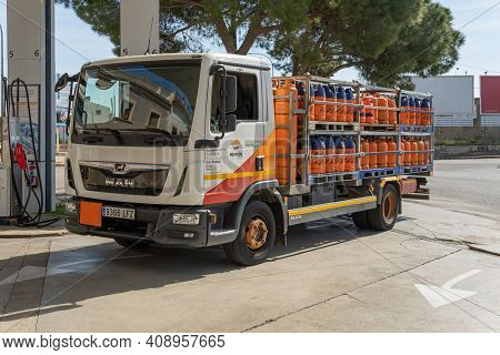 Campos, Spain; February 18 2021: Repsol Butane Cylinders Truck Parked At A Gas Station On A Sunny Da