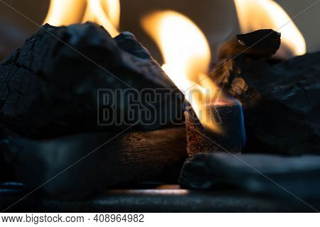 Glowing Barbecue Charcoal Briquettes In A Bbq Coal Lighter. Fire Flame Is Started Using Fire Starter