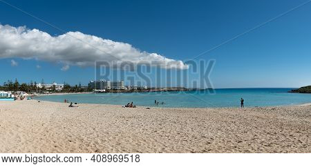 Ayia Napa, Cyprus., February 14 2021: People Resting In The Empty Beach Due To Covid 19 Pandemic. Ni