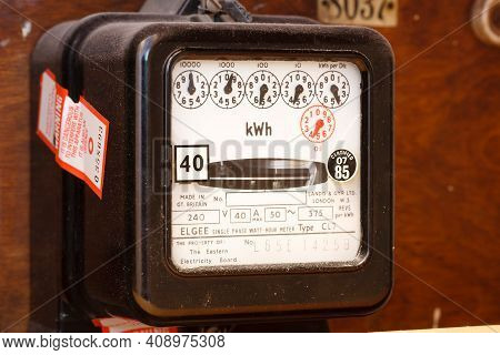 London, Uk - January 23, 2012. Analogue Electricity Meter, Old Domestic Electric Meter With Dials, U