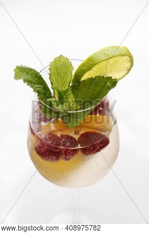 Refreshing Summer Drink, Lemonade With Raspberry Fruits, Ice Cubes, Mint Leaves, Lime, Orange Slices