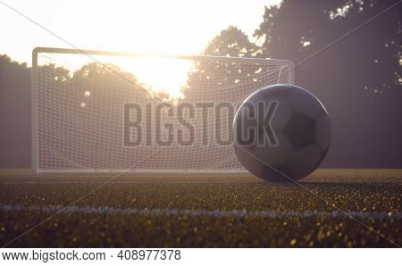 Soccer Ball On The Field With The Sunset In The Background. Depth Of Field With Focus On The Ball. 3