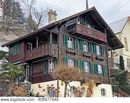 Traditional Swiss Houses And Old Residential Architecture In Weesen Settlement On The Shores Of Lake